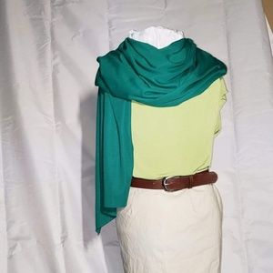 Green blouse brown leather belt green scarf skirt